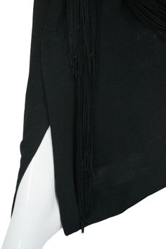 Gilbert Adrian custom label rare vintage dress example of Adrian's creative ability to use silk fringe to transform a relatively simple black rayon crepe dress into a masterpiece.
