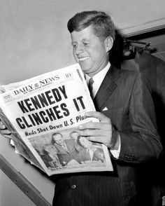 John F. Kennedy, President of the United States, reads about his victory in Daily News in 1960.