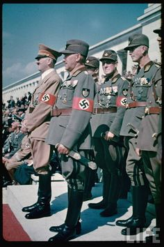 Hitler and an entourage on the reviewing stand at the 1937 Reichsparteitag (Party Congress) in Nuremberg, photographed by Hugo Jaeger