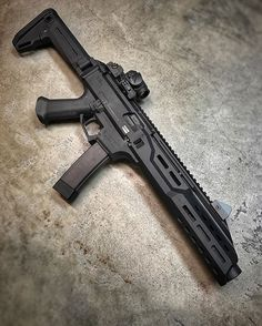 Scorpion EVO SBR with a carbine hand guard and a perfectly fitting Omega - Tap the link to see the newly released survival collections for tough survivors out there! Survival Weapons, Weapons Guns, Guns And Ammo, Submachine Gun, Custom Guns, Assault Rifle, Cool Guns, Military Weapons, Scorpion