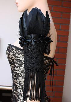Black swan cuff by Pinkabsinthe.  http://www.etsy.com/shop/pinkabsinthe