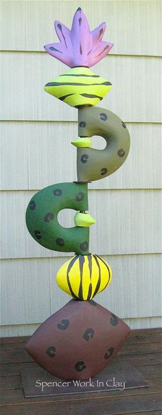 Sculpture Stack for Home or Garden with Terra Red, Yellow, Green, Chartreuse and Purple Ceramic Pieces. $650.00, via Etsy.