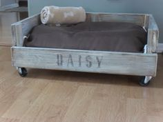 This is a movable dog bed made from an old crate.
