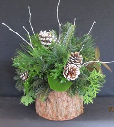 Christmas pinecones and greenery Christmas Flower Arrangements, Christmas Greenery, Holiday Centerpieces, Christmas Flowers, Rustic Christmas, Xmas Decorations, Floral Arrangements, Christmas Holidays, Christmas Wreaths