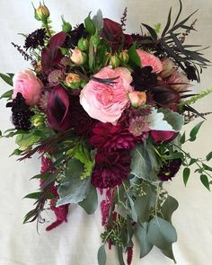 Bohemian cascading burgundy bridal bouquet with amaranth, eucalyptus, roses, dahlias, calla lilies, and scabiosa. Fleurish Floral Designs
