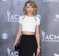 Pin for Later: Announcing the 2014 POPSUGAR 100! Taylor Swift  Rose from 28 on the 2013 POPSUGAR 100 Wrapped up her worldwide Red tour Won the Country Music Association's Pinnacle Award  Source: Getty/Axelle