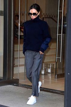 The beautiful Victoria Beckham has gone from Posh to a sought-after designer and has remained stylish every step of the way. The modern-wardrobe queen steps out looking sleek in an oversized turtleneck sweater, grey trousers and white sneakers.