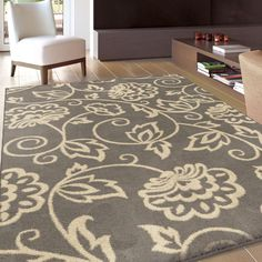 For the living room  This large and beautiful area rug was made to help unify the decor and style of any room. The subtle coloration and minimal floral pattern are perfect as either an accent to a strong room, or the perfect centerpiece of a room that is much more minimal.
