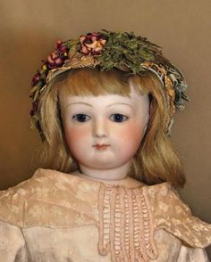 OVERVIEW: This is a very sweet Jumeau French Fashion lady with a perfect bisque head. Her kid body carries the Jumeau stamp. She is fully dressed in a lovely sheer pink print gown, full unders, antiqu