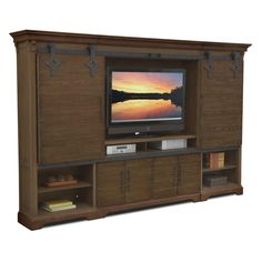 Casual Connection. The Union City entertainment wall unit in brown ties together a whole family room and all its inherent activities. Construction of hardwood solids and ash veneers gives this four-piece unit a reliable sturdiness and helps achieve a look of casual industrial. Piers flank the unit and provide lots of opportunity to display your most treasured items. Architectural elements abound, and TV display area doors slide easily across the unit on an antiqued, textured metal roller…