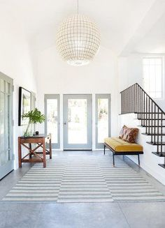 Large entryway with oversized pendant chandelier