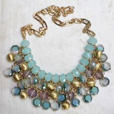We love the crystal and jewel details on this floral statement necklace.