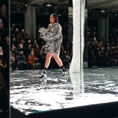 Pin for Later: Step Inside Rihanna's Fashion Week Show But She Closed the Show in a Totally Different Look She bundled up on top, no trousers on bottom.