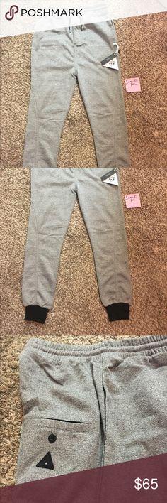 NWT I Love Ugly Grey Track Pants size L NWT I Love Ugly Grey Track Pants size L 100% Authentic. These retail for $100 I love ugly Pants Sweatpants & Joggers