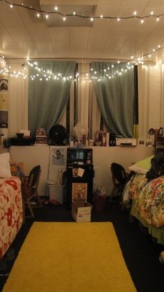 Her dorm room is soooo cute! I love the curtains they added and the xmas lights, adorable! Looks like it came straight out of pottery barn teen :)