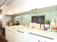 Kishani Perera: White and green galley kitchen design featuring glossy white lacquer cabinets paired ...