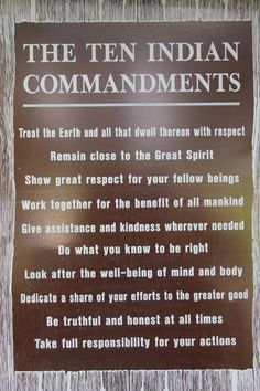 Sign above an indian statue in the upper peninsula