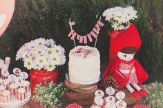 Little Red Riding Hood themed birthday party with Lots of Really Cute Ideas via kara's party ideas! full of decorating ideas, dessert, cake, cupcakes, favors and more! KarasPartyIdeas.com #littleredridinghood #littleredridinghoodparty #woodlandparty #woodlandpartyideas #partydecor #partyplanning #partystyling #eventstyling #partyideas (10)