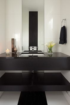 Powder Room - Simplistic elegance wrapped up in black & white.  Now, this is lovely.