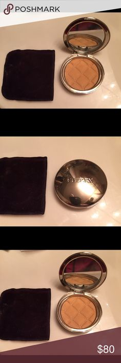 By Terry Densilis pressed powder #5 By Terry Densilis Powder Compact, swatched only on hand it's too dark. Brand new all my listings are 100% Auth. I hate fakes! Pouch comes with compact. Open to reasonable offer's!! No Low Ball offers Please!! Thank You PLEASE NO LOW BALL OFFERS! ITS RUDE I WILL AUTOMATICALLY DECLINE! By Terry Makeup Face Powder