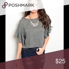 Deal of the Day🌻Gray Blouse with Flutter Sleeves Cropped knit top features short flutter sleeves and rounded neckline. It is cropped in the front and long in the back. Probably something I would pair with some high-waist jeans or shorts!! The tops are true to size. Very soft and comfortable.  I would love to answer you have below & I always consider a reasonable offer. Tops Blouses
