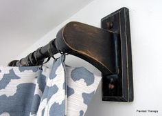 Love the drapes and using wood paper towel holders from Home Depot is genius!