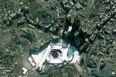 Amazing Satellite Photo Gallery of Famous Landmarks on Earth - Thrillist Ferrari World, Earth From Space, Famous Landmarks, Far Away, Cemetery, City Photo, Photo Galleries, Places To Visit, Gallery