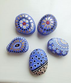 Paint pebbles, buy magnets at Hobby Lobby/Walmart