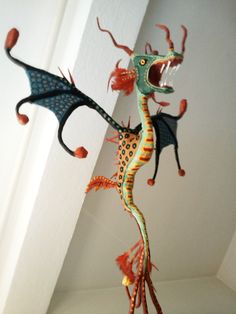 Here is a paper mache dragon
