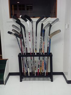 Let a Hockey Puck Black Stick Storage unit help you stay organized!