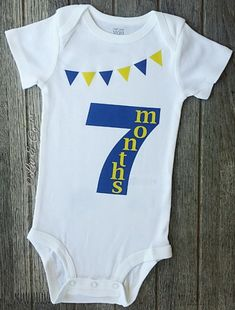Our 7 month old milestone outfit is the perfect outfit for your baby boy or girl to celebrate their 7th month of life in. This one piece romper is part of a line I've designed and every month is available making it the perfect baby shower gift set! More colors and designs available.