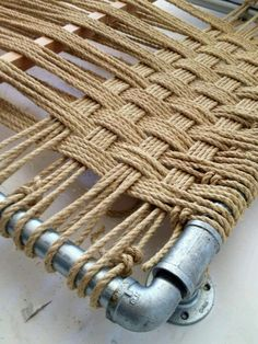 Rope weaving for a headboard.