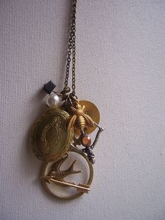 The Hunger Games charm necklace. It's actually pretty cute...