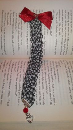 Braided ribbon bookmark w/ pewter heart charm & red glass bead, handmade by me =)