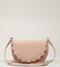 "AEO Scalloped Crossbody Bag in blush    Visual interest.  Polyurethane        • Soft faux leather      • Scalloped front flap      • Perforated details      • Long crossbody strap      • Concealed snap closure         • Interior patch pocket      • Lined      • 9.5""L x 7""H x 2""D"