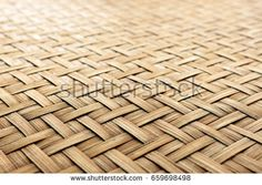 closeup bamboo weave texture with soft-focus and over light in the background