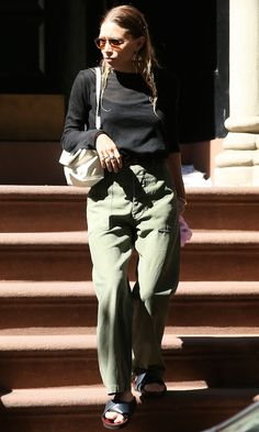 Ashley Olsen // aviator sunglasses, black long sleeve tee, white bag, army green pants & leather slide sandals #style #fashion #mka #olsentwins #nyc