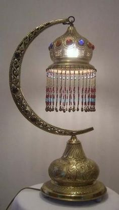 Half Moon Beaded Brass Table Lamp – Buy this beautiful handcrafted, oriental and beaded half moon design table lamp at affordable prices. It will add an extra texture and style to any interior design.