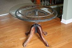 Mamie Jane's - LOVE this table...made with wheel chair wheel, stool base and glass top!!
