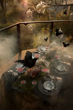 10 Spooky Table Settings for Halloween via Brit + Co. Mossy Runner: For an Edgar Allen Poe-approved affair, dress the table like you landed in a graveyard with a mossy table runner. You'll probably have some wide-eyed guests at that table, which is what you're going for anyway, right? (via Little Big Company)
