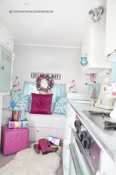This is awesome! Vintage pink and turquoise camper decorated for Christmas...check out more pictures at this blog