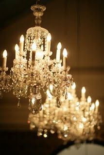 Wouldn't it be amazing to have three elaborate chandeliers lined up like this over a long dining room table?