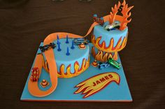 A fun Hot Wheels cake for my little Hot Wheels fan!! See more at https://www.youtube.com/user/cakesbysharon