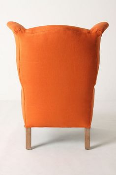 Back of Anthropologie's Howell Wingback chair as giant Uglydoll