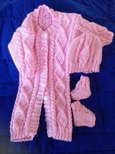 A personal favourite from my Etsy shop https://www.etsy.com/uk/listing/454497958/irish-knit-snowsuit-in-pink-with