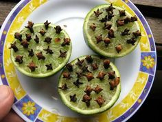 Cut limes in half and stick in cloves. Natural mosquito repelant