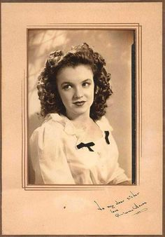 "The vintage portrait of Norma Jean Dougherty, also known as actress Marilyn Monroe, with a rare autograph and dedication ""To my dear sister,"" is on display in this undated photo for Sotheby's 2001 online auction of articles from the collection of Monroe's half-sister, Bernice Miracle."
