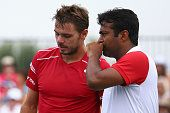 #WawrinkaPaes #PaesWawrinka #Wawrinka #LeanderPaes #tennis Stanislas Wawrinka of Switzerland talks with Leander Paes of India during their doubles match during Day 3 of the Western Southern Open at the Linder...