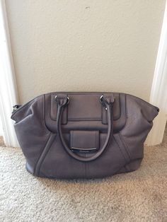 MAKOWSKY HANDBAG! 100% genuine leather, soft feel. Never used. Still has stuffing inside. A can't miss! This color goes great with any outfit, soft steel grey. Love it! (Will ship within 1 business day)