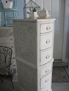 DIY Furniture: A couple of nightstands, now a pretty lingerie chest.love the tin ceiling tiles!Salvaged dressing table drawers were covered with tin ceiling tiles, stacked & painted. - Fox Home DesignStack 2 parts of a dressing table, add tin ceiling Furniture Projects, Furniture Making, Furniture Makeover, Home Projects, Diy Furniture, Modular Furniture, Farmhouse Furniture, Furniture Design, Antique Furniture